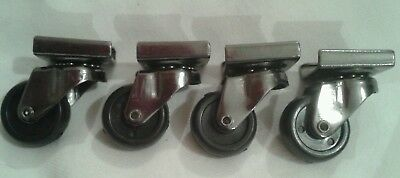 Four wheel casters with ball bearings for smooth swivel action.