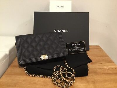 c6d7f9486fe1 100% Authentic Chanel Woc Boy Bag Wallet On Chain Gold New Caviar Leather