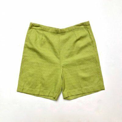 Vintage 1960s high waisted, chartreuse, textured cotton shorts with centre back