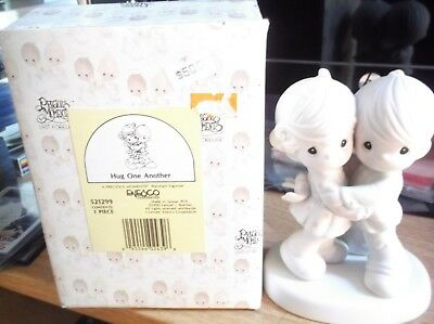 New In Box Precious Moments Hug One Another Porcelain Figurine