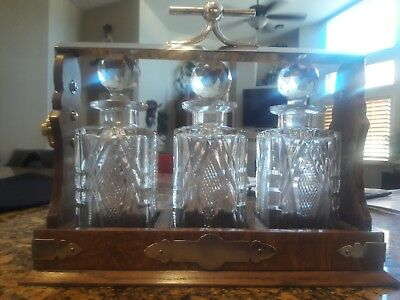 Vintage Liquor caddie with 3 glass decanters and sterling silver plate top