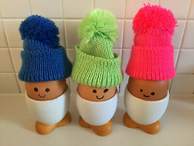 Egg cups with woollen hats