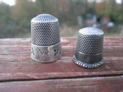 2 Lovely Antique Sterling Silver Thimbles 1 larger than most with stork
