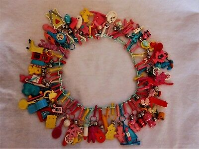 Vintage 1980's Bell Clip Plastic Charm Necklace with 60 Charms