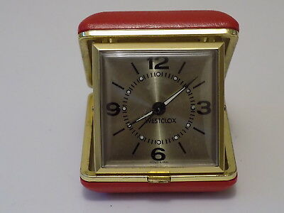 Westclox Travel alarm clock brass face red case tri fold