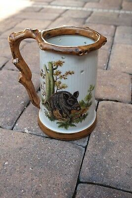 Schedel trick German beer stein. Boar theme, lady at the bottom