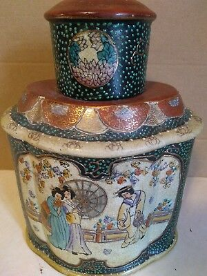 vintage Asian urn.. Decanter with cup for lid ,very ornate piece..rare