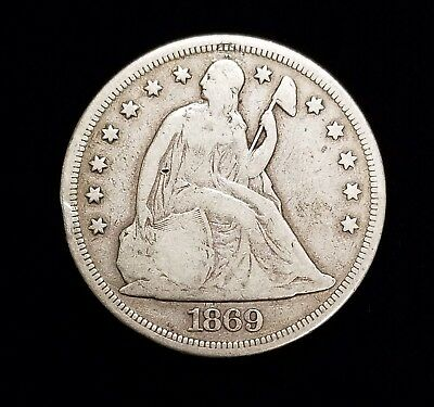 1869 Seated Liberty Silver Dollar in Fine Condition