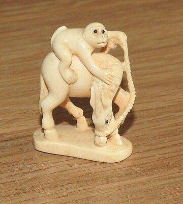 Japanese netsuke, monkey on a horse, carved in bone and signed, quality carving,