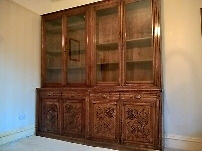 antique mahogany bookcase with glass top doors.