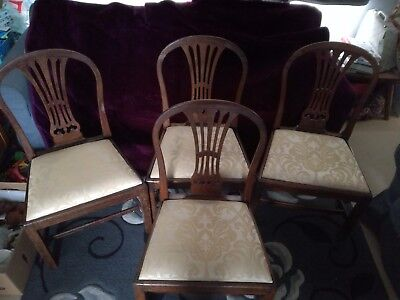 Four Georgian Mahogany Hepplewhite Chairs with padded drop in seats