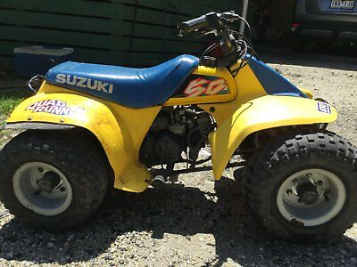 Suzuki Quad Bike - 50cc plus Helmet