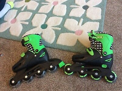 boys roller blades adjustable size 13-3 excellent condition.