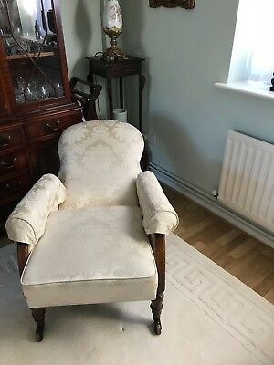 antique reclining Edwardian oak armchair.
