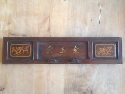 Vintage Chinese wooden panel with flowers and script