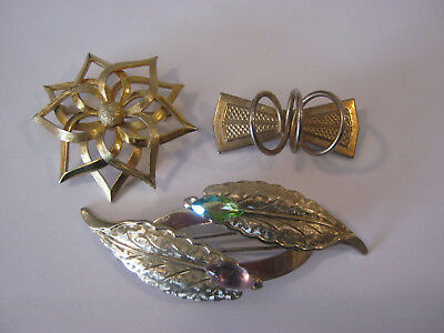 Vintage brooches, 3 gold tone brooches, etched leaf, modernistic, & a floral pin