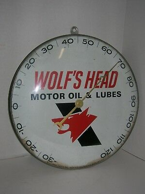 Wolf's Head Motor Oil & Lubes Thermometer Pam Clock Inc. 12'' round.