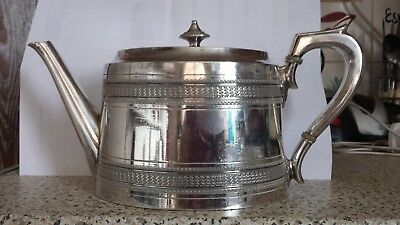 A Vintage Silver Plated Tea Pot With Engraved Patterns.