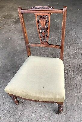 Carved Edwardian nursing chair on castors soft green velvet seat