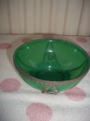 Green glass Chinese Bowl,with metal trim and dragons.