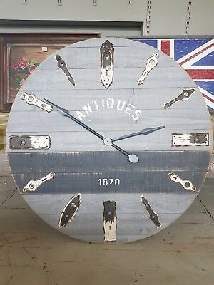 Clock made with reclaimed wood and Antique Door lock plates.