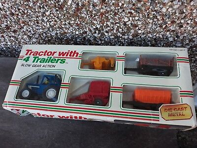 Blue Tractor Diecast WITH 4 Trailers Boxed by Slow Gear Action * RARE