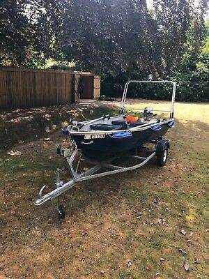 Aluminium boat with galvanised trailer outboard motor and accessories
