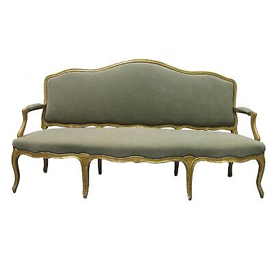 A late 19th Century French gilded sofa in the Louis XV style