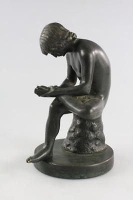 Antique Hand Carved Bronze Figural Of A Seated Boy