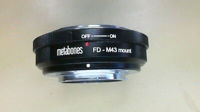 Metabones FD-M43 mount. Canon FD fit lens to Olympus micro four thirds camera.