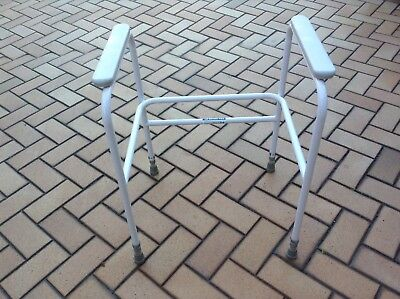Toilet frame support. White powder coated. Used.  Good condition.