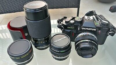 Olympus OM40 35mm SLR Film Camera with lenses & accessories.