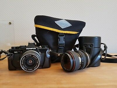 Olympus OM 2N 35mm SLR Camera and lens, strap, case, and zoom lens with case