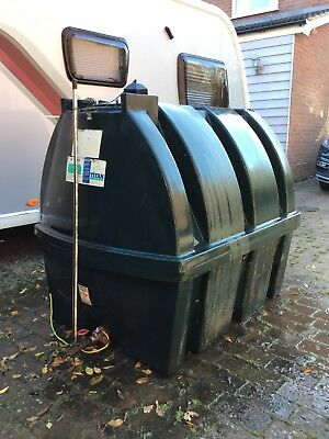 Plastic heating oil tank, Titan H1250, 1250 litre tank with a few litres of oil.