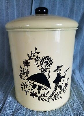 "Vintage Yellow Metal Canister,With ""GARDENING COUPLE""DESIGN;10""T X 7 1/4""D"