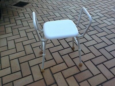 Shower chair, adjustable height. Good condition.