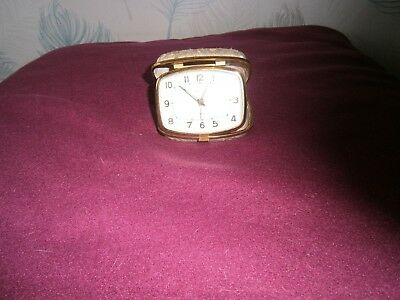 Vintage Europa 4 jewels Travel Alarm Clock In A Gold & Cloth Material Case.