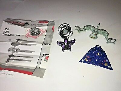 Random Lot of 4 Bakugan Battle Brawlers, Beyblade metal fusion & instructions
