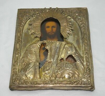 Antique icon of Jesus Christ the Almighty in brass frame the middle of the 19th