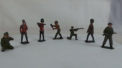 7 Lead Toy Soilders. Vintage. Poss all Britain's? . Two are marked Britain.