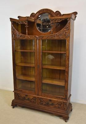 Antique ATurn Of The Century Oak Two Door Bookcase Carved Round Beveled Mirror