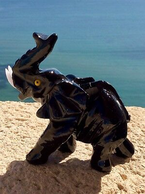 Natural black onyx hand carved elephant. Made in Peru