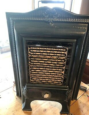 Vintage Electric Cast Iron Enammaled Heater.