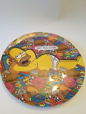 Homer Simpson in his underwear with hamburger, duff beer, doughnuts plate,