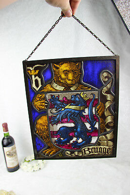 Old Flemish stained glass window symbol escutcheon city of bruges bear lion