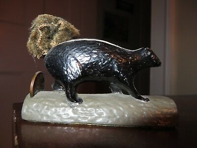metal old vintage skunk on log w 1938 penny fuzzy tail 'one cent'