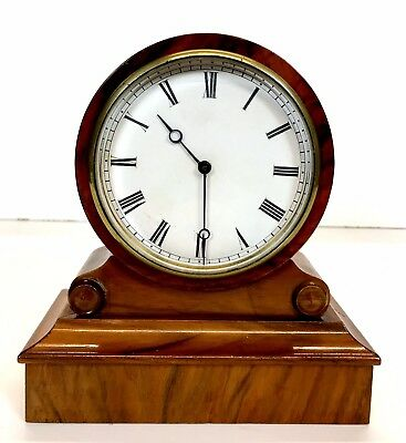 A Walnut Drum Clock With A French Brevete Movement