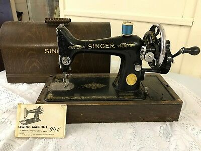 Vintage Singer 99k hand crank sewing machine with original wooden case