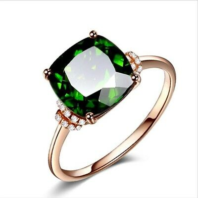 Stunning Emerald and Diamond created Rose Gold ring.