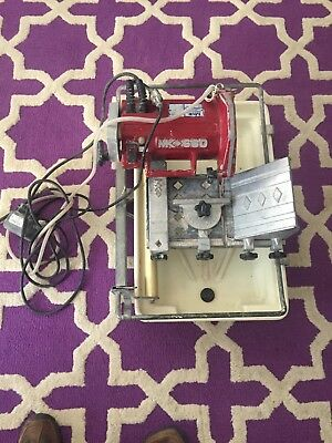 MK-660 Tile Saw with Rip & Miter guides pump, stand Good shape local pick up